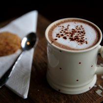 hot chocolate in cup on wooden board