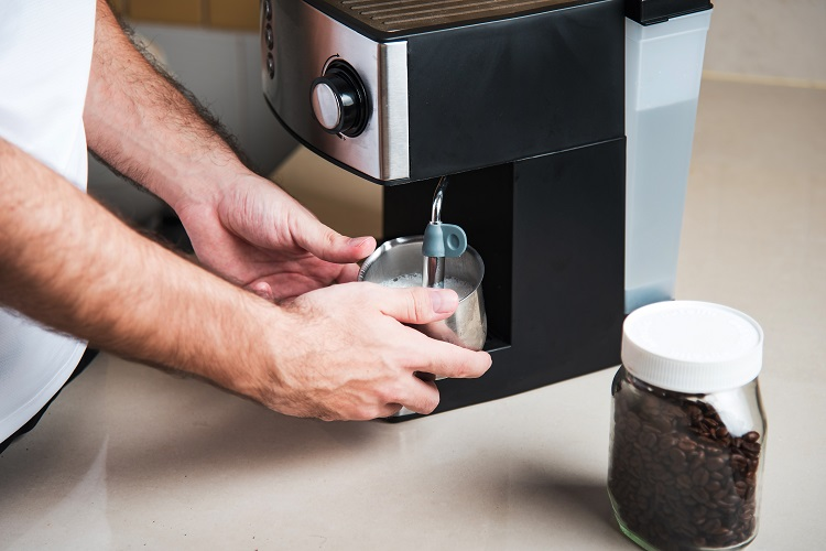 Person,Using,Espresso,Machine,Milk,Frother,For,Making,Coffee.,Home