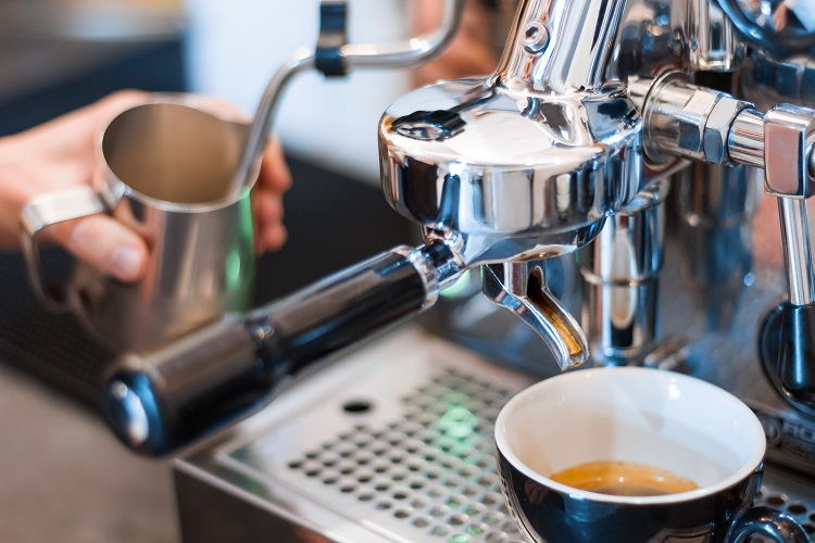process of making brewing americano with a barista coffee machine