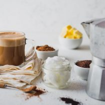 Coffe and cacao blended with coconut oil. Cup of bulletproof coffe made with a milk frother